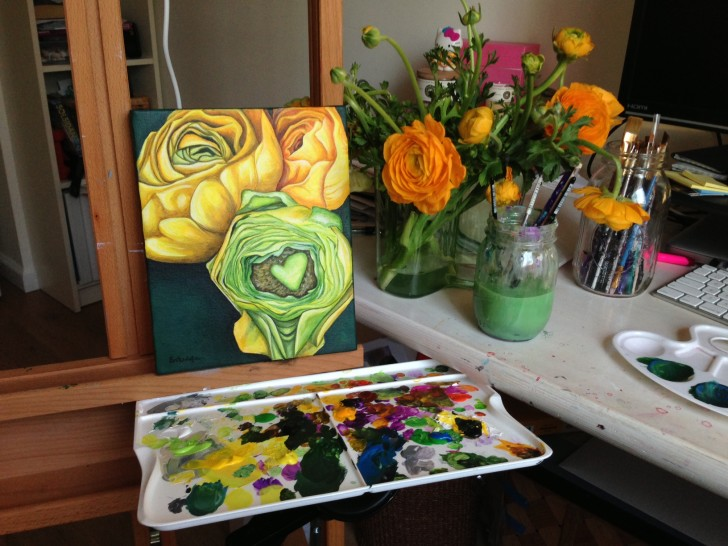 Yellow Ranunculus next to the real flowers.