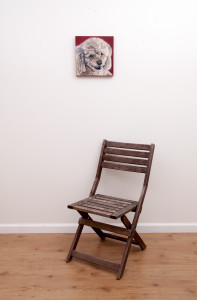 Pet portrait of a french bulldog by artist Erica Eriksdotter and a chair