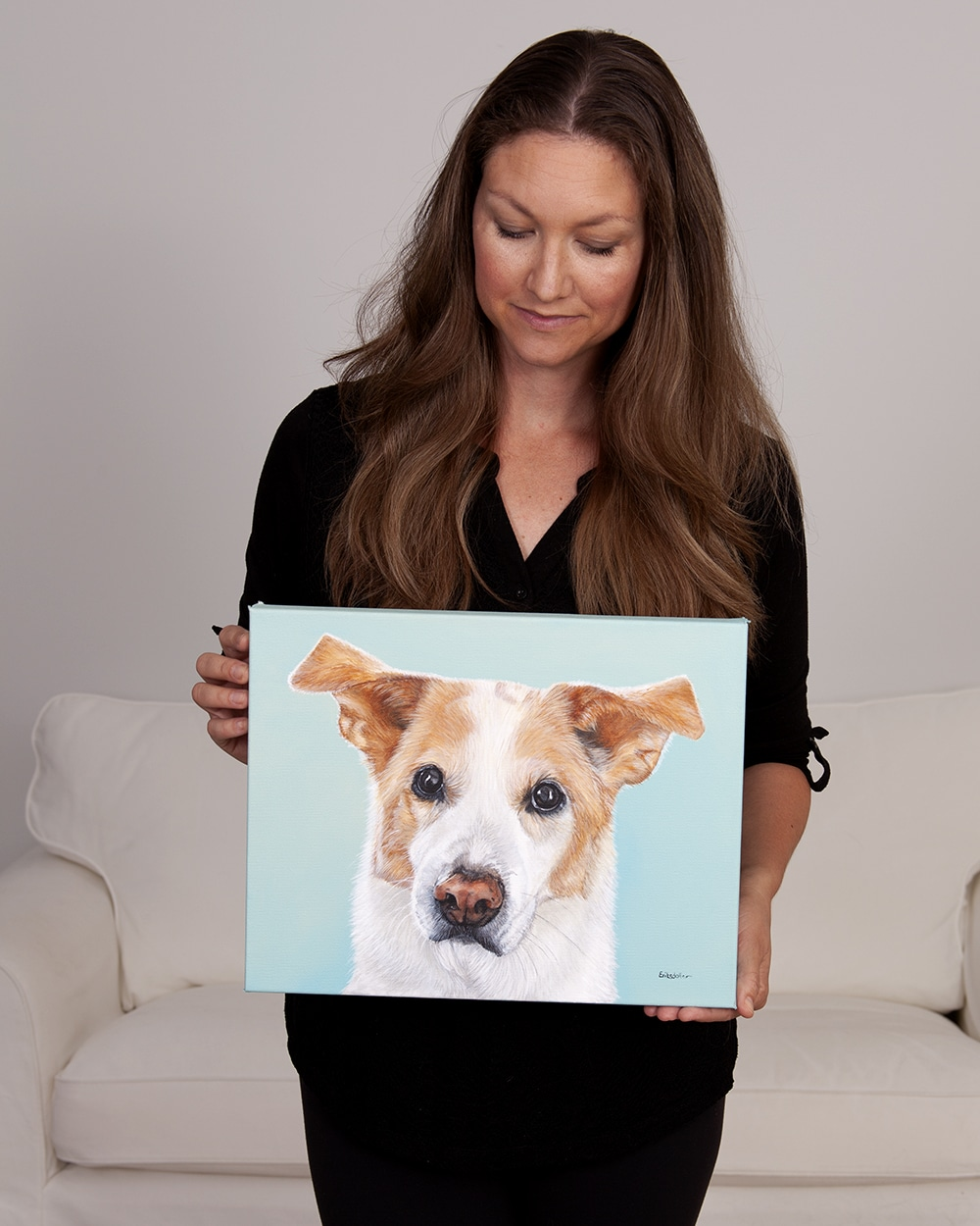 Fine arts painter Erica Eriksdotter with her original acrylic painting of a lab, collie and husky mix pet portrait