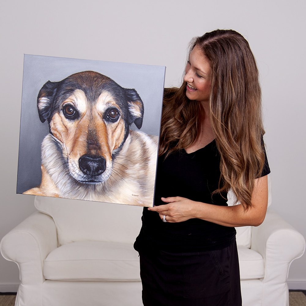 Fine arts painter Erica Eriksdotter with her original acrylic painting of a labrador retriever mix pet portrait