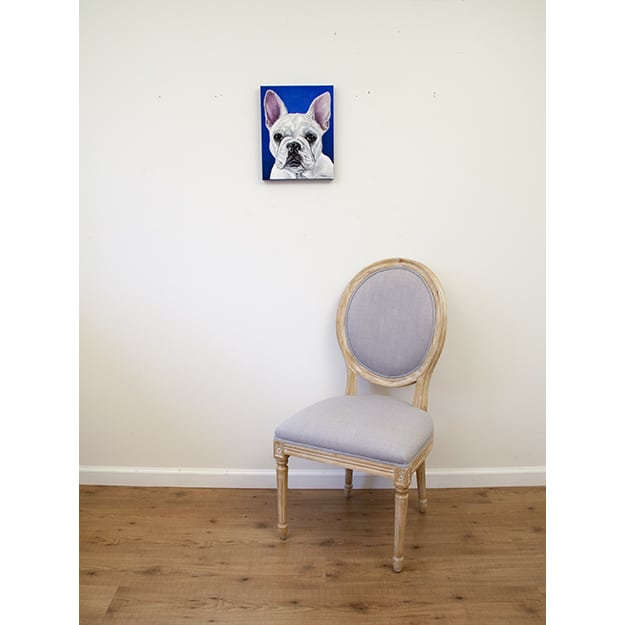 Fanny's original pet portrait of a white bulldog on blue background