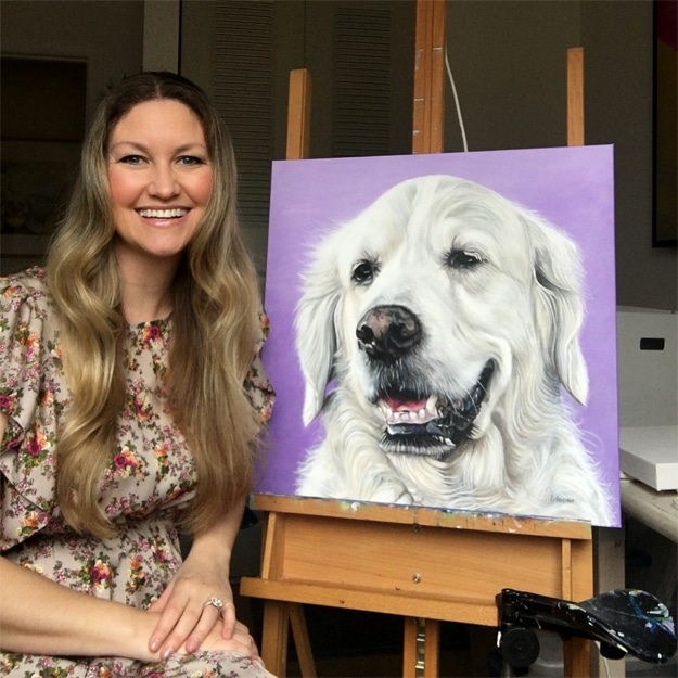 Erica Eriksdotter sitting by the easel with Rosie's Pet Portrait