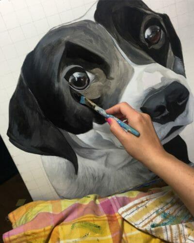 Erica Eriksdotter paints a portrait of a border collie dog